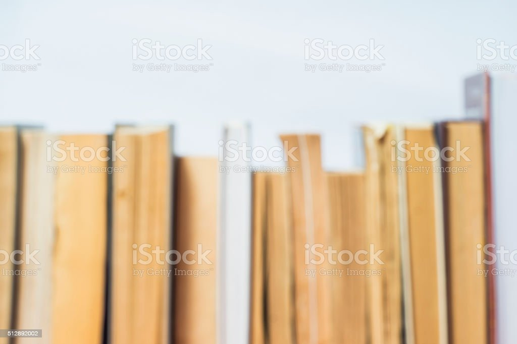 Stack of old books blurred background. stock photo
