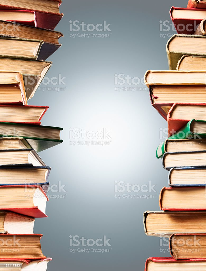 Stack of old books used as border royalty-free stock photo
