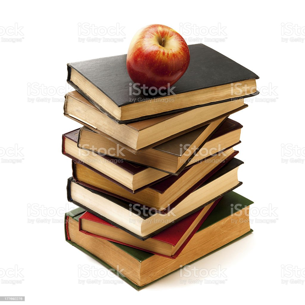 Stack of Old Books With an Apple on Top royalty-free stock photo