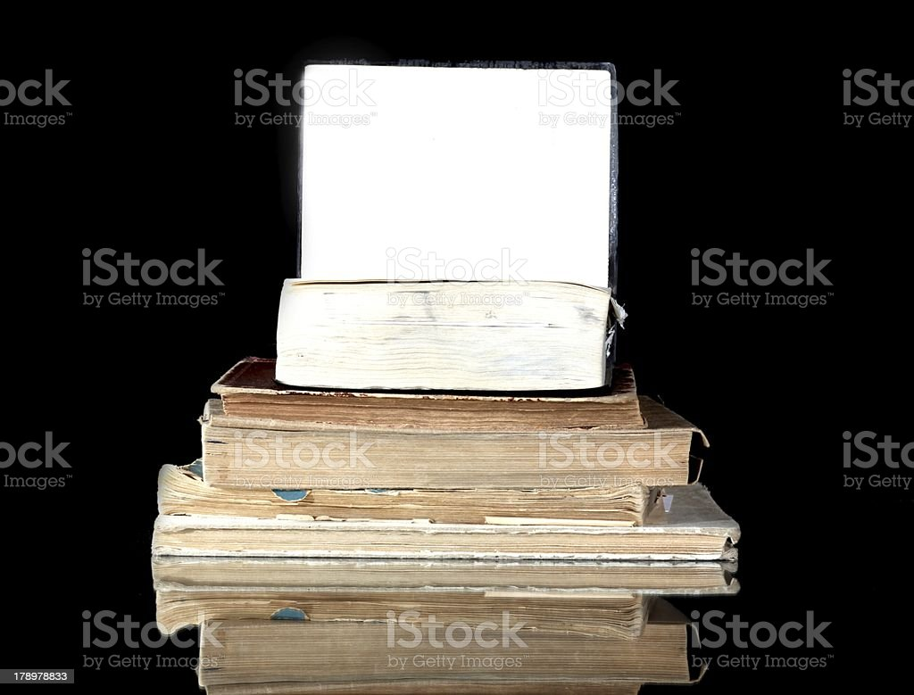 Stack of old books with blank page reflected royalty-free stock photo
