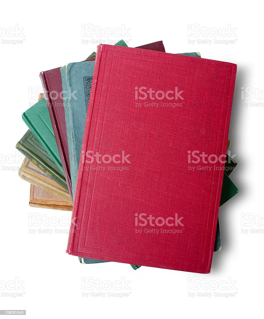Stack of old books with blank red book on top royalty-free stock photo