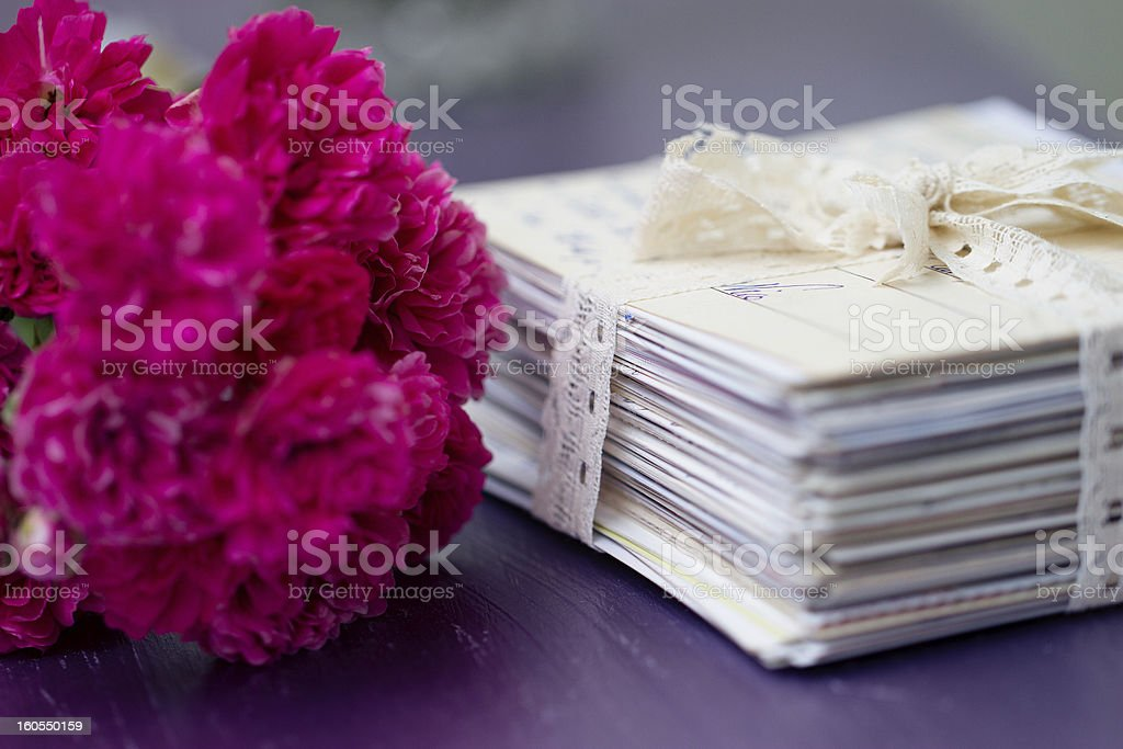 stack of old letters with roses royalty-free stock photo