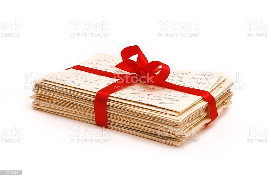 Stack of old love letters bonded with red ribbon stock photo