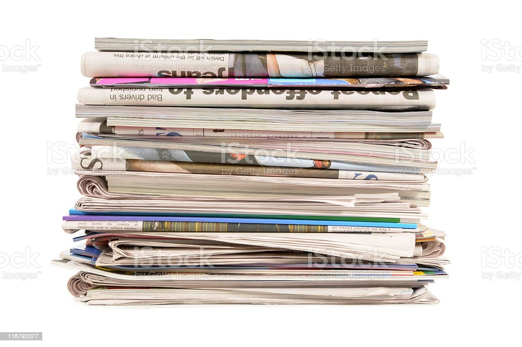 Stack of old newspapers and magazines on a white background royalty-free stock photo
