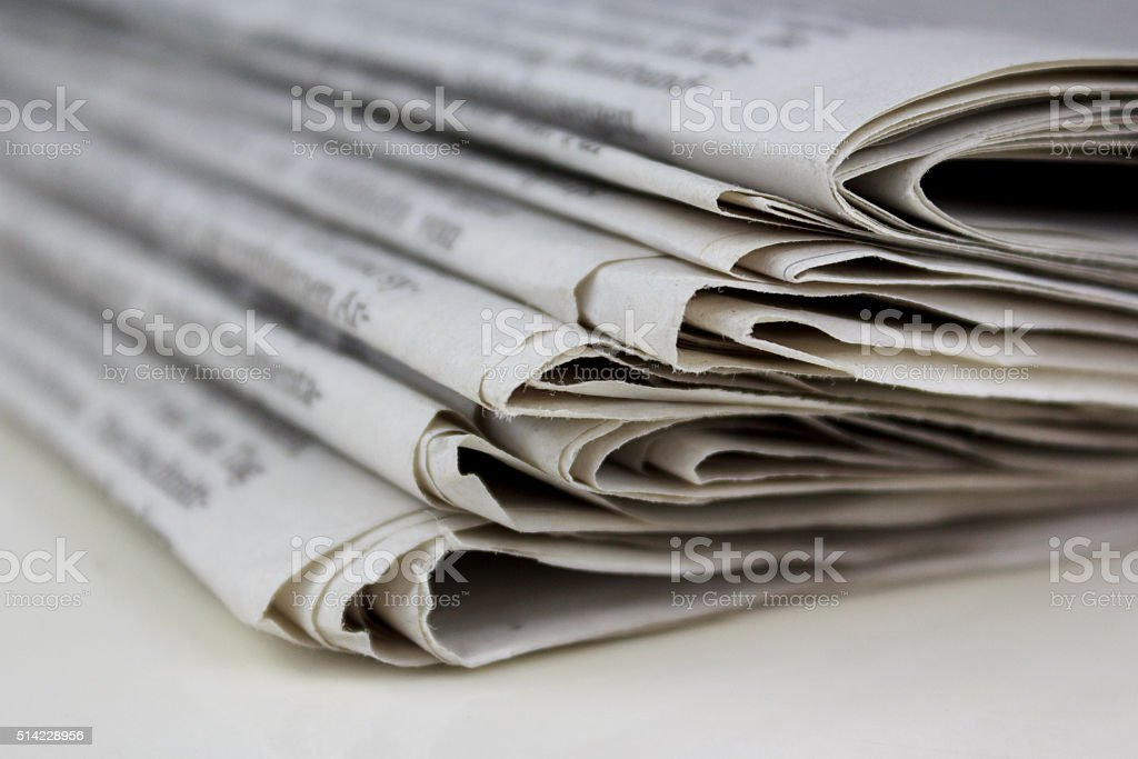 stack of old newspapers, pile of old newspapers stock photo