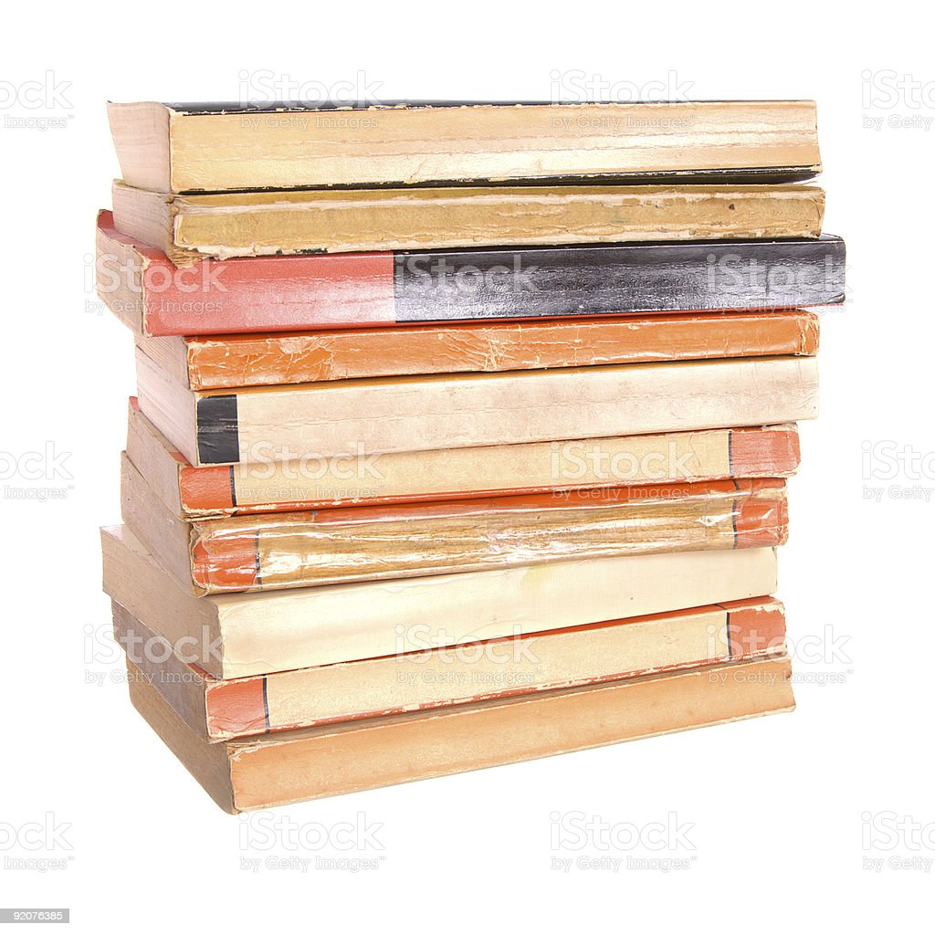 A stack of old paperback books and their spine stock photo