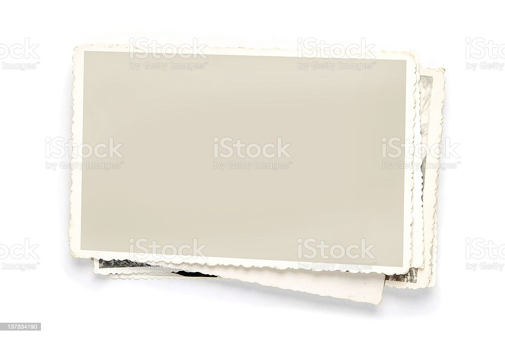 A Stack of old photo graphs with cream frames stock photo