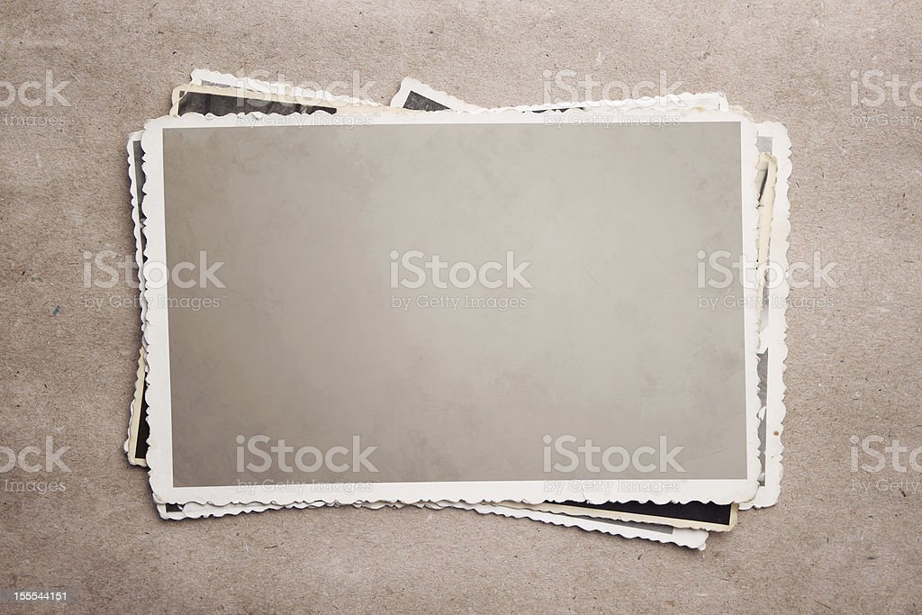 A stack of old photograph clippings stock photo