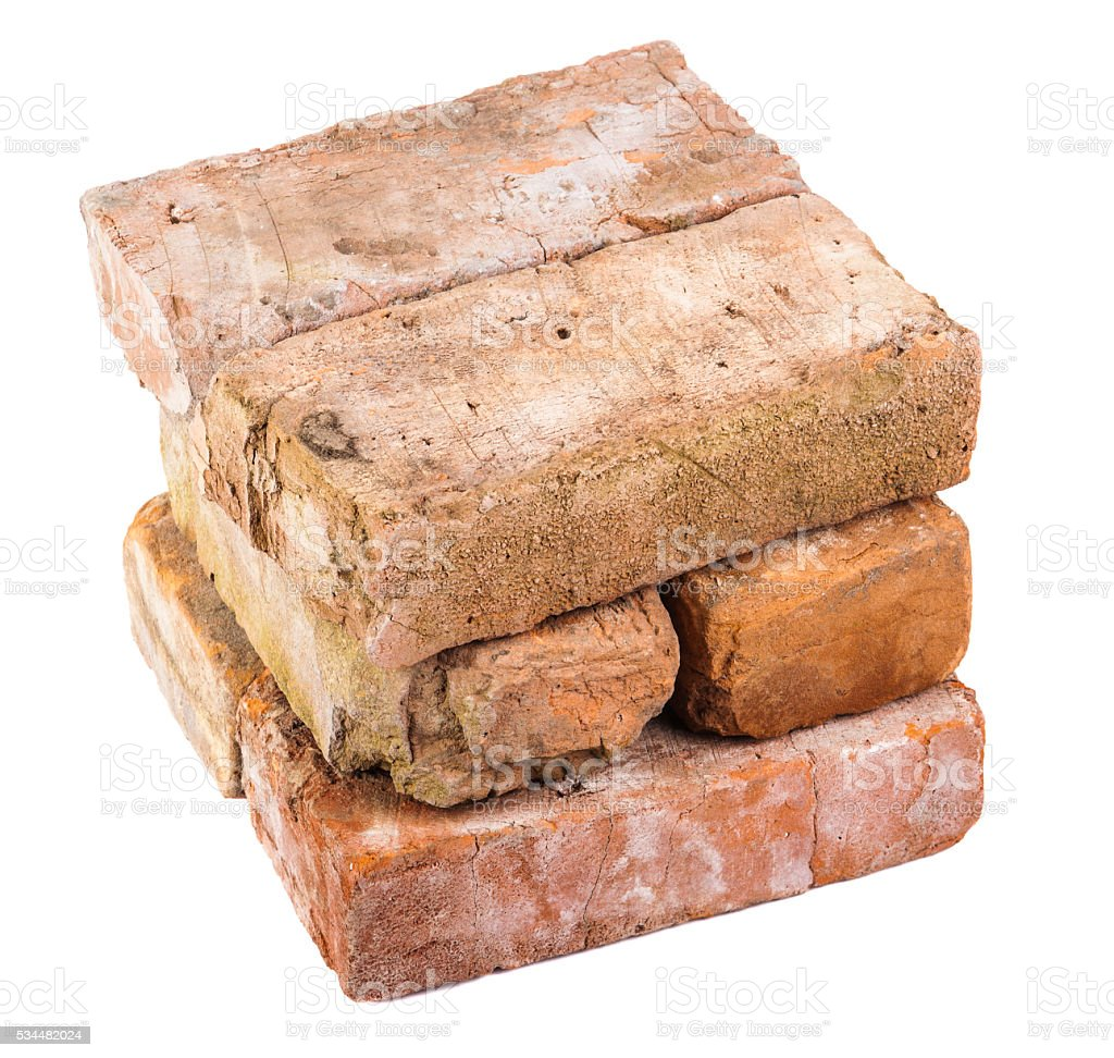 stack of old red bricks. isolated on white background stock photo