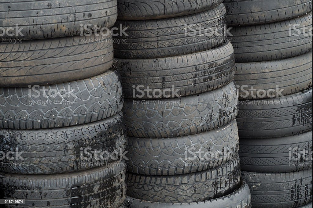 stack of old rubber tires used wheels for recycling stock photo