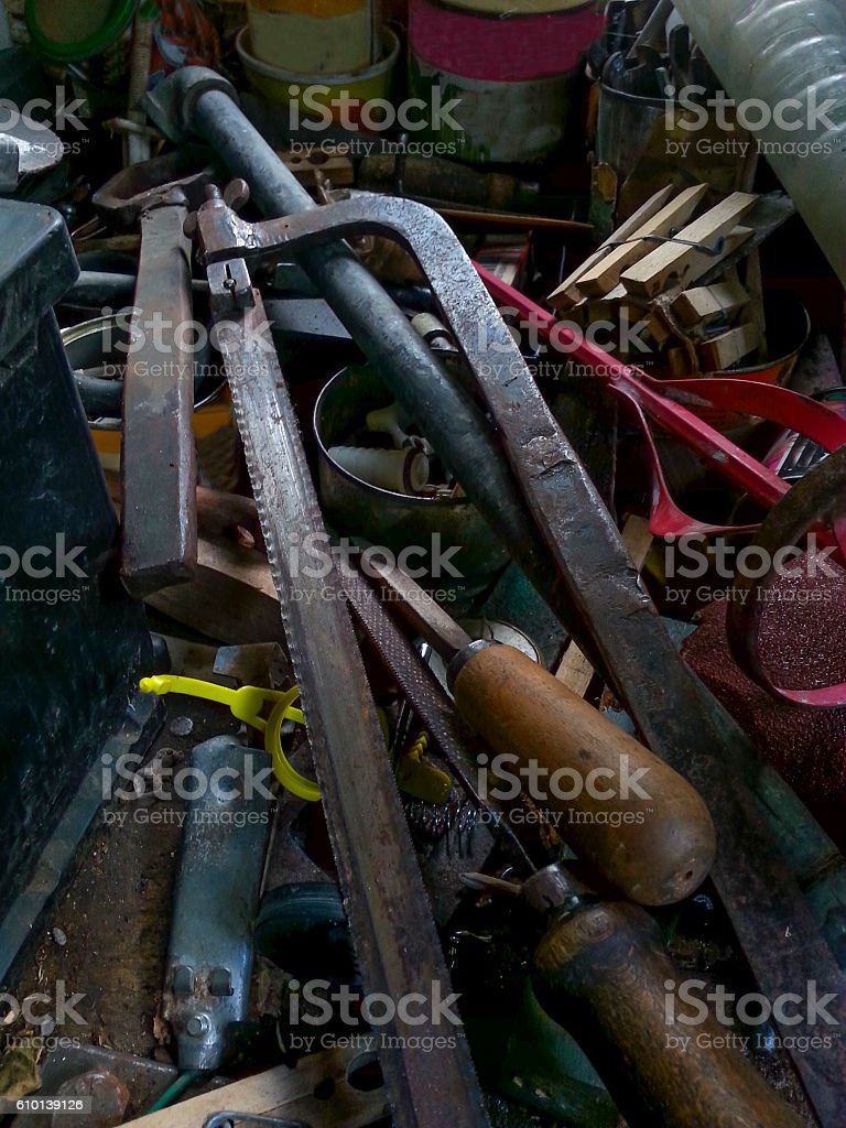 Stack of old tools in the workshop of my grandfather stock photo
