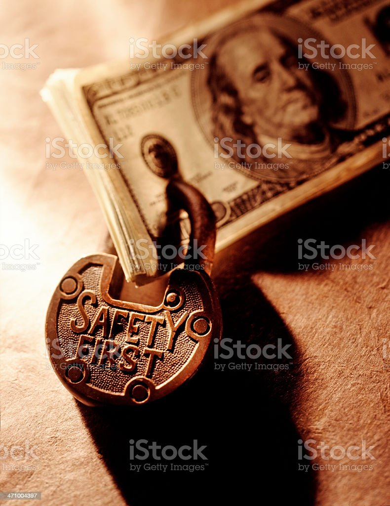 Stack of One Hundred Dollar Bills Padlocked Together royalty-free stock photo