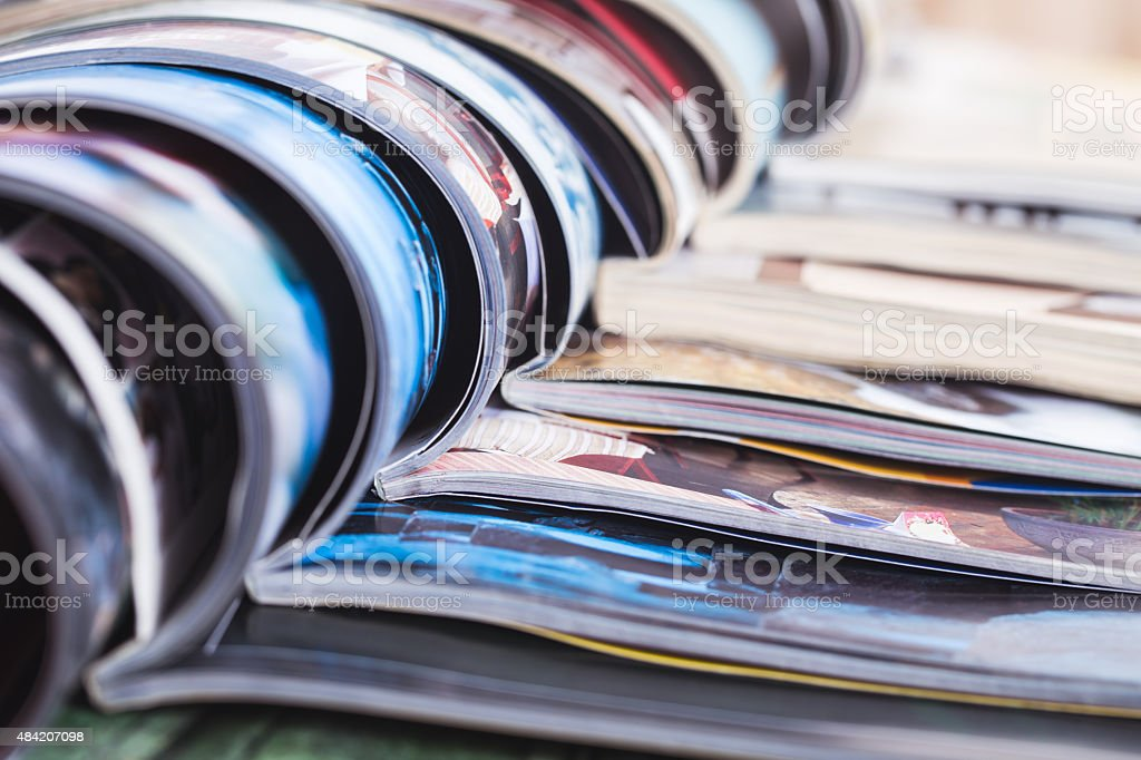 stack of open colorful magazines. information stock photo