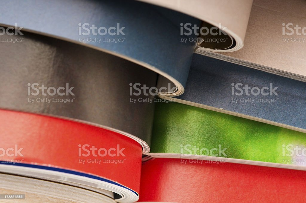 Stack of open magazines royalty-free stock photo