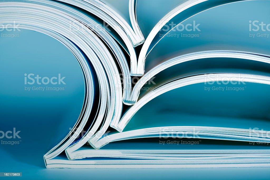 Stack of opened magazines royalty-free stock photo