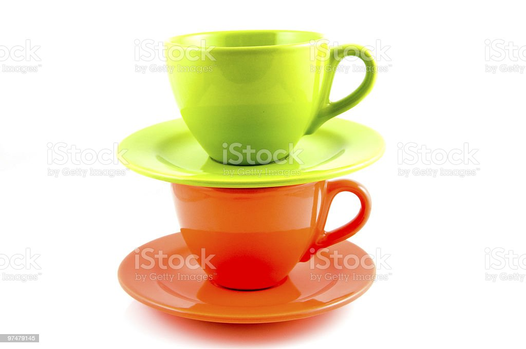 Pile d'orange et vert et une tasse à café photo libre de droits