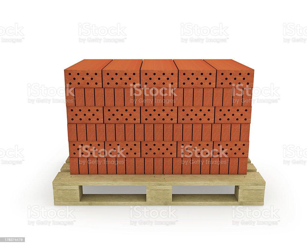 Stack of orange bricks on pallet, isolated stock photo