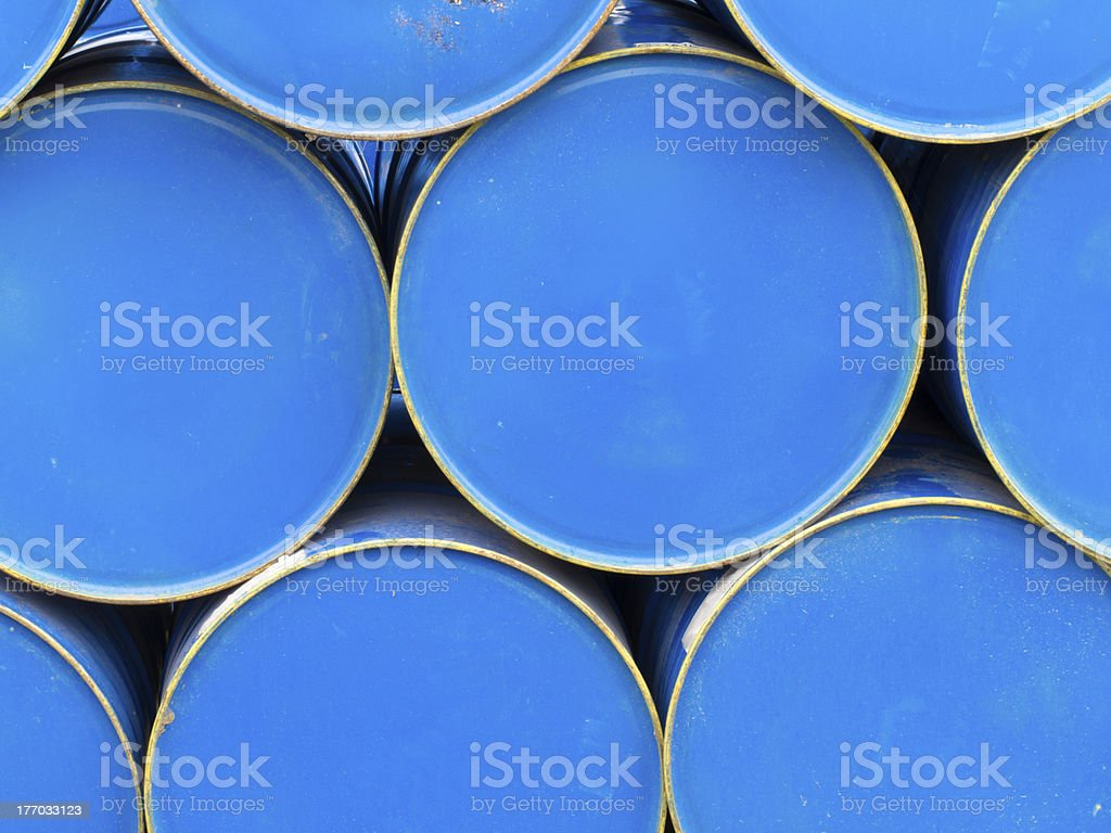 Stack of painted blue oil barrels royalty-free stock photo