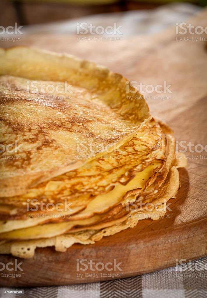 Stack of pancakes on a wooden board stock photo