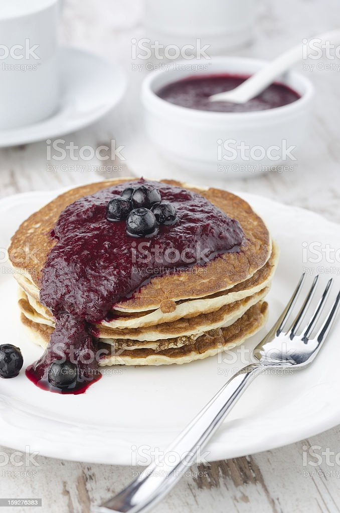 stack of pancakes with black currant jam on a plate royalty-free stock photo
