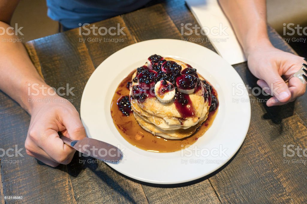 Stack of pancakes with blueberries and bananas stock photo