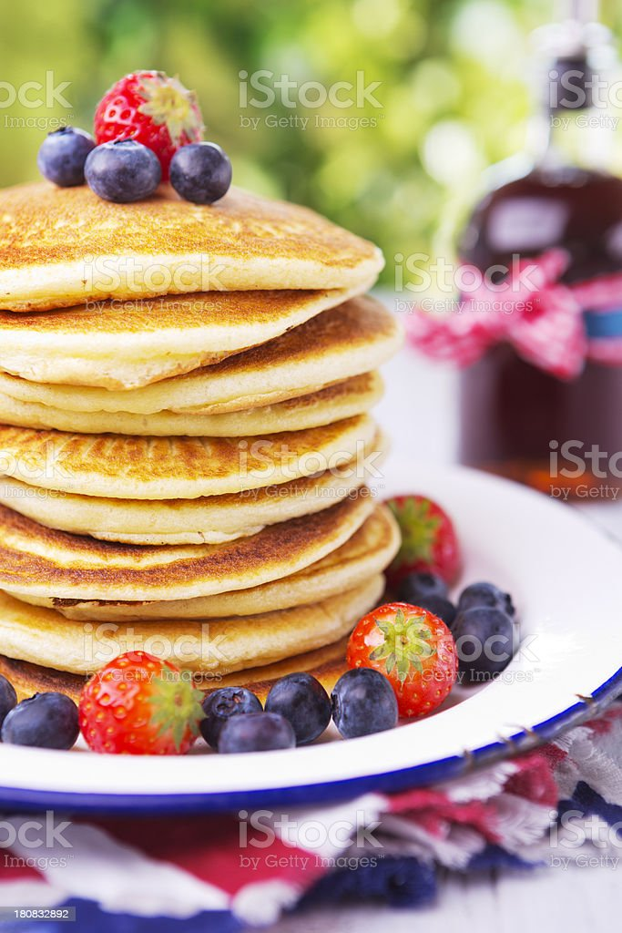 Stack of pancakes with fresh fruit and syrup royalty-free stock photo