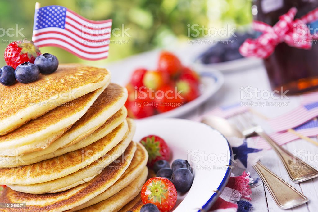 Stack of pancakes with fresh fruit royalty-free stock photo