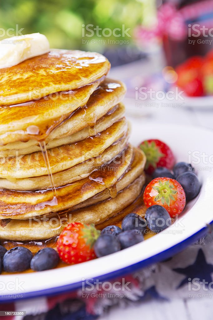 Stack of pancakes with fresh fruit, syrup and butter royalty-free stock photo