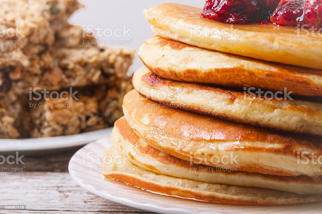 Stack of pancakes with glass of orange juice stock photo