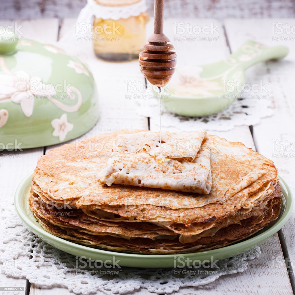 Stack of pancakes with honey and butter stock photo