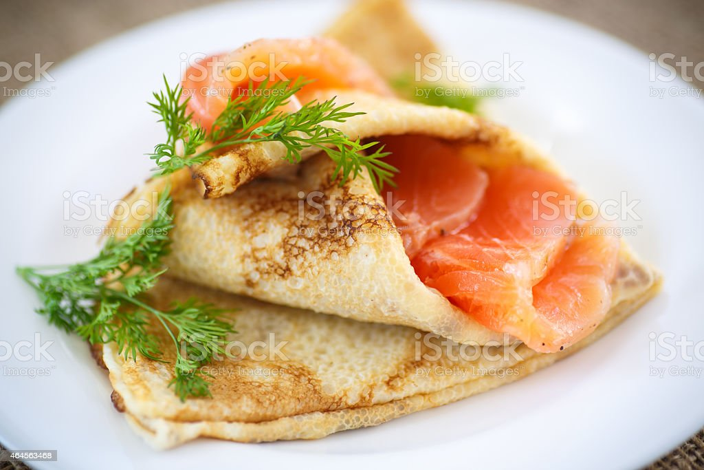 stack of pancakes with salted salmon stock photo