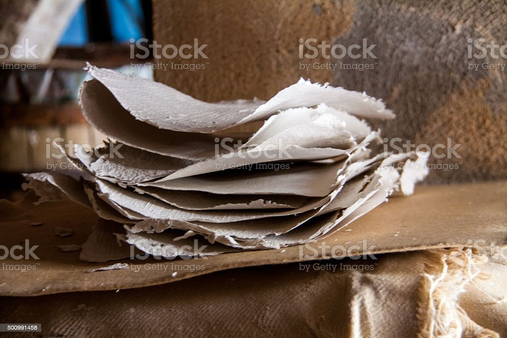 Stack of paper sheets in an ancient paper mill stock photo