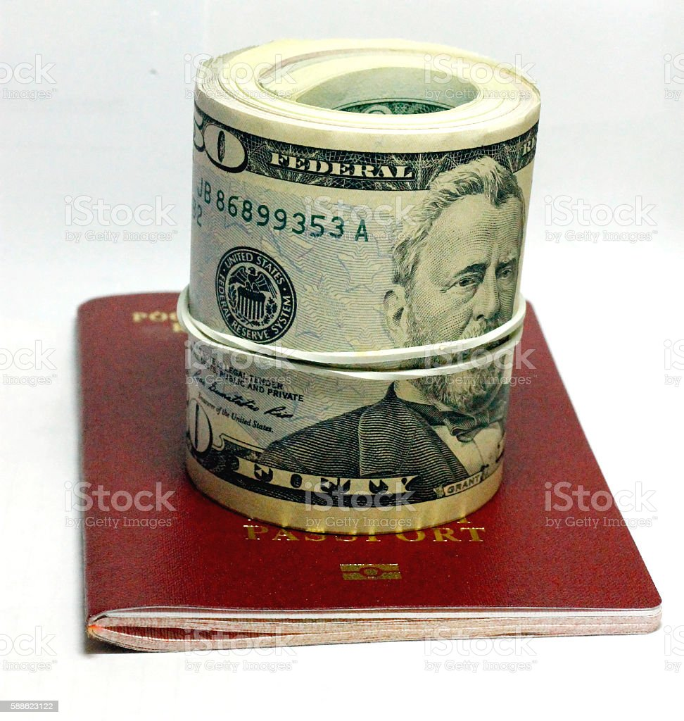 Stack of paper usa dollars over the red passport stock photo