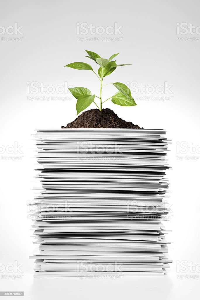 Stack of paper with green leaf stock photo