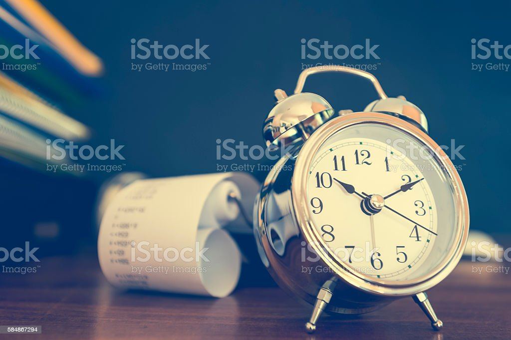 Stack of paperwork and files with calculator and clock stock photo