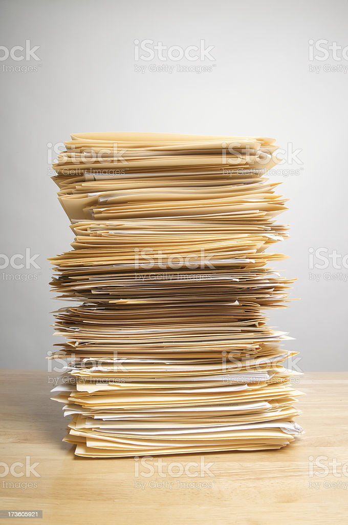 Stack of Paperwork Files on Desk Inbox royalty-free stock photo