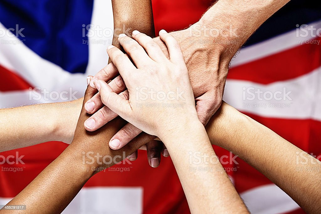 Stack of patriotic hands on Union Jack royalty-free stock photo