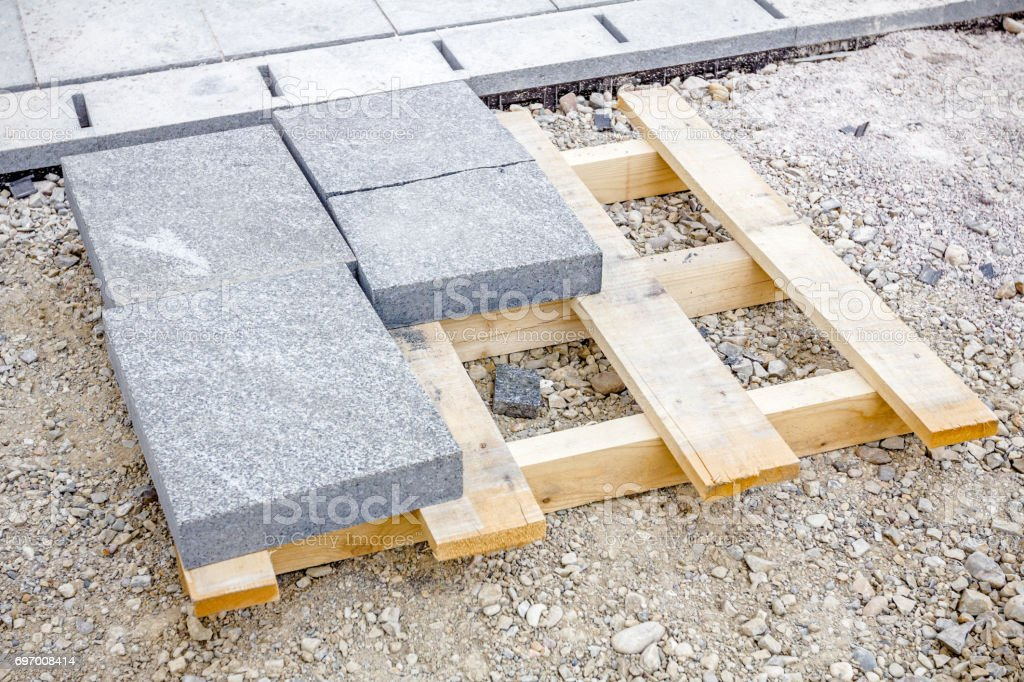 Stack of paving slabs piled on wooden pallet stock photo