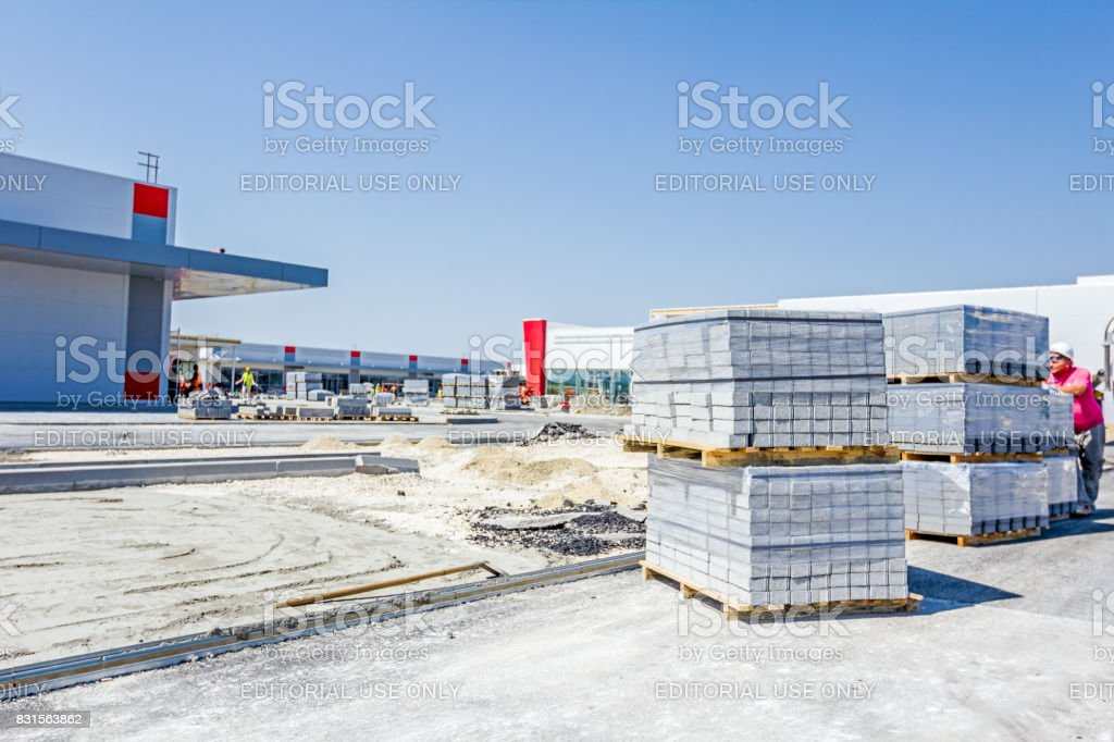 Stack of paving slabs piled on wooden pallets stock photo