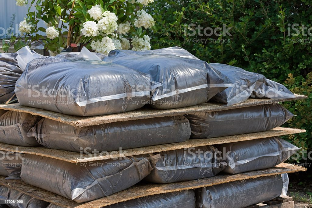 Stack of Peat Potting Soil in Plastic Bags royalty-free stock photo