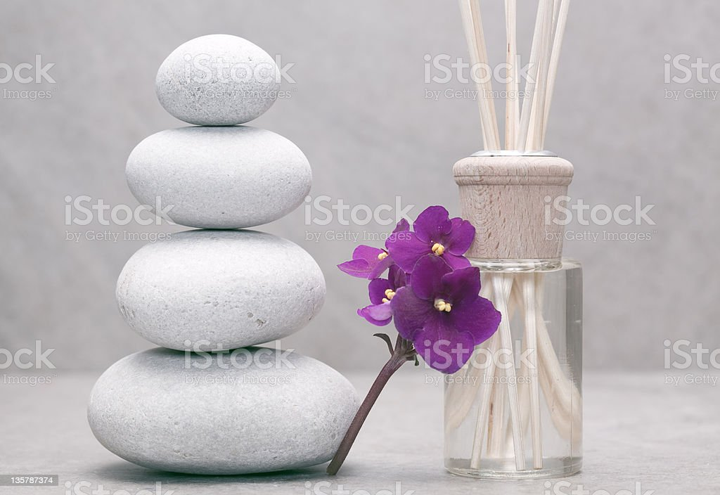 stack of pebble stones flower and bottle with fragrance sticks royalty-free stock photo