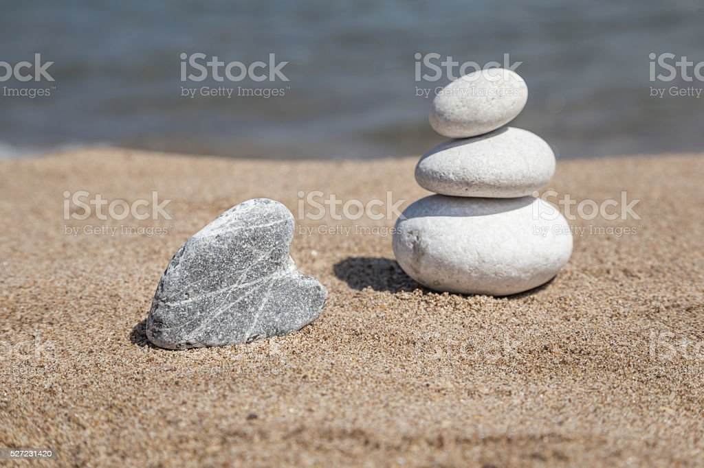stack of pebble stones on balance on beach stock photo