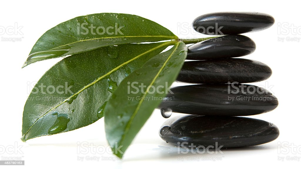 Stack of pebbles and Leaves stock photo