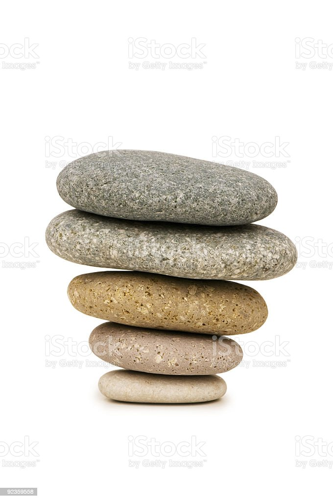 Stack of pebbles isolated on the white background royalty-free stock photo