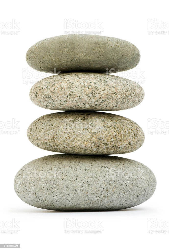 Stack of pebbles isolated on the white royalty-free stock photo