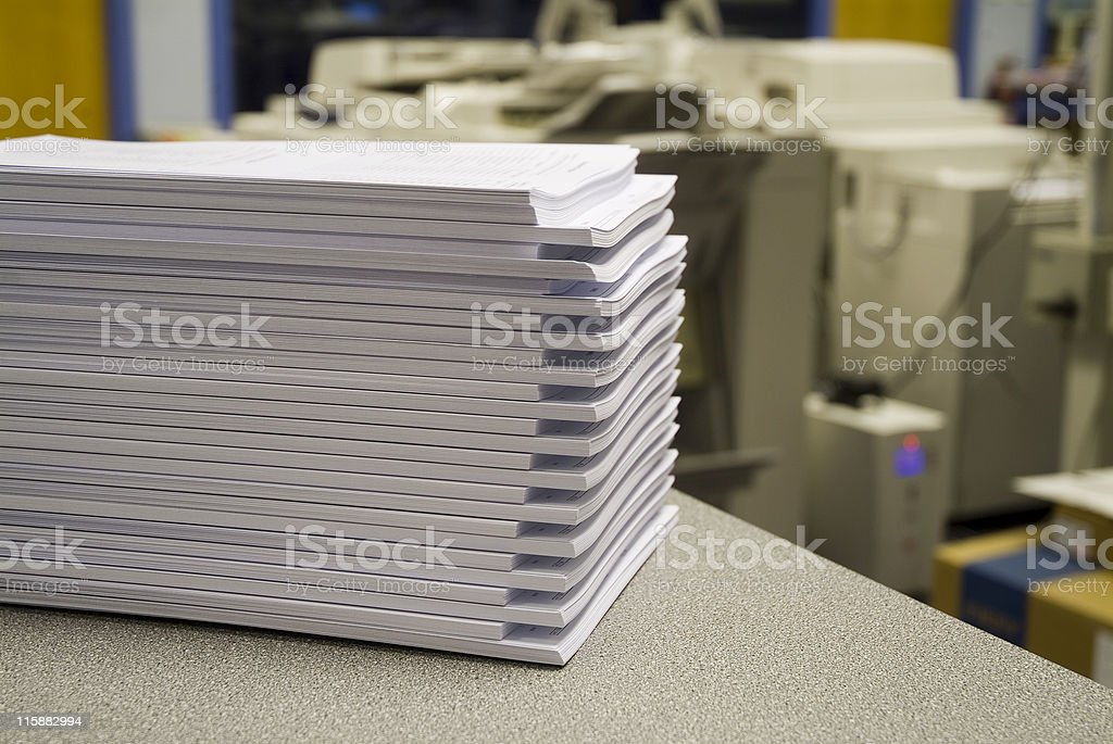 Stack of photocopies on counter stock photo
