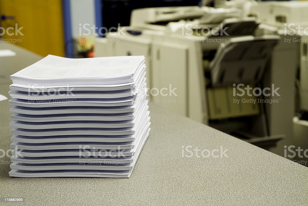 Stack of photocopies sitting on an office desk stock photo