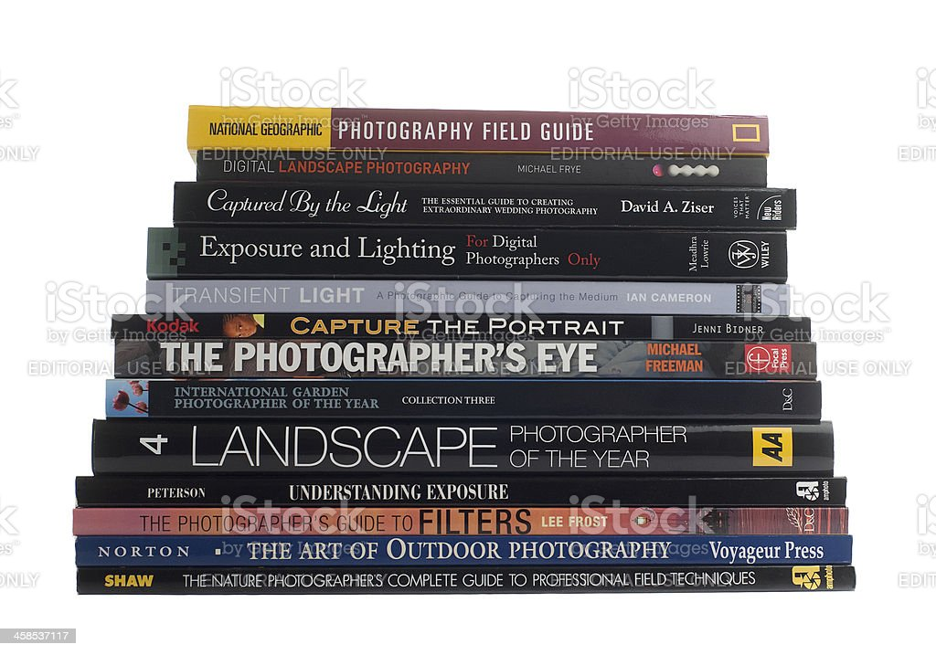 Stack of photography books on white background stock photo