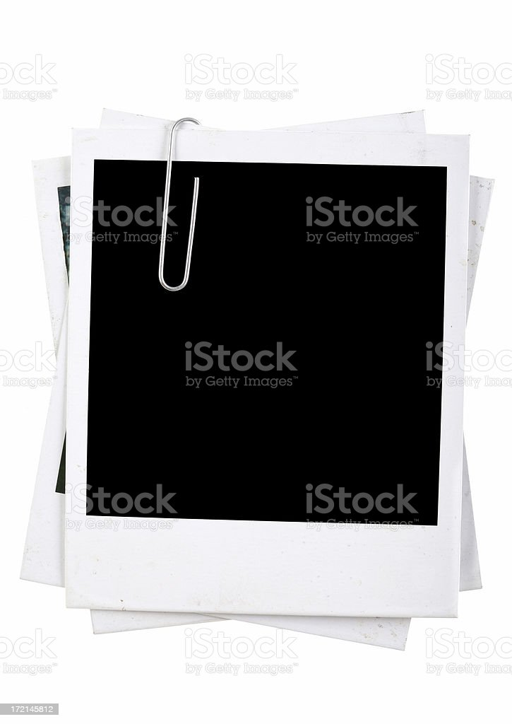 Stack of photos held with Paper Clip stock photo