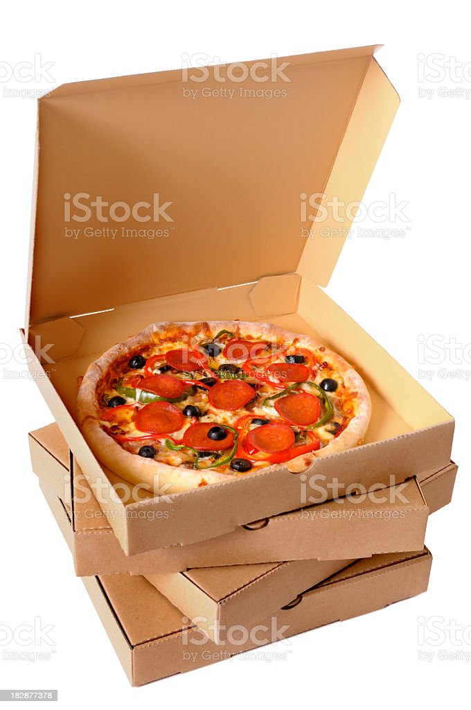 Stack of pizza boxes with top open to reveal fresh pizza royalty-free stock photo